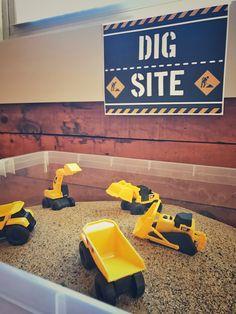 Construction theme birthday party: Indoor Sandbox w/small equipment toys.
