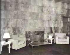 Jean-Michel Frank's design for the sitting room in the penthouse of Templeton Crocker, San Francisco, 1929. The walls and ceiling were covered in squares of parchment, while the armchairs were upholstered in white leather. One of the Parsons-style cocktail tables was covered in brown shagreen, while the other was sheathed in patina bronze.