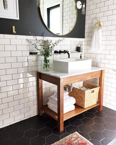 """371 Likes, 2 Comments - Better Homes & Gardens (@betterhomesandgardens) on Instagram: """"The bathroom envy is settling in. The contrast of the dark wall + light subway tile is perfection!…"""""""