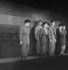 Men in police line up wearing zoot suits. January 01, 1942 photo: Peter Stackpole/Time & Life Pictures/Getty Images