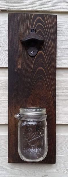 Recycled pallet bottle opener with cap catcher