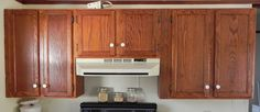 We've seen tons of painted cabinets, but her idea with stones? Amazing