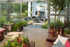 industrial patio by Groundswell Design Group, LLC