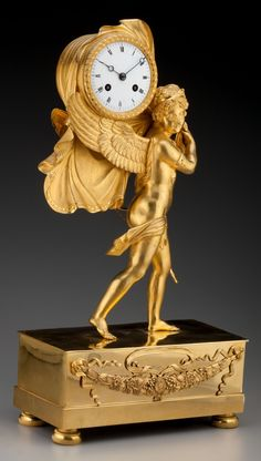 Timepieces:Clocks, A French Empire Gilt Bronze Figural Mantel Clock: Cupid,first half century. inches high x inc. Unusual Clocks, Cool Clocks, Big Clocks, Wall Clock Brands, Wall Clock Online, Antique Mantel Clocks, French Clock, Classic Clocks, Retro Clock
