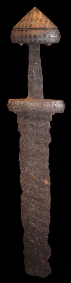 Viking sword from Gotland. Pommel and hilt are layed in with copper, and silver.