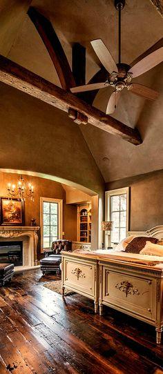 Rustic master bedroom....Beautiful wood floor, ceiling beams
