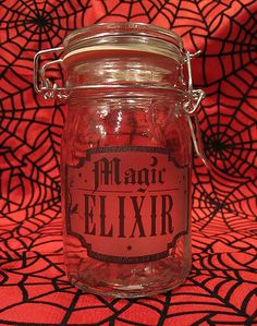 Items similar to Magic Elixir Glass Apothecary Jar - Horror Gothic Spooky Home Decor on Etsy Diy Halloween Jars, Halloween Decorations, Halloween Crafts, Happy Halloween, Glass Apothecary Jars, Mason Jars, Dragon Glass, Halloween Silhouettes, Decorated Jars