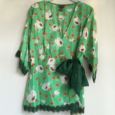 Anthropologie Kimono Styled Floral Silk Blouse Fei Beautiful Asian inspired floral print wrapped 100% silk blouse with intricate lace around the sleeves and hem. It' a statement piece. In mint condition - only worn once. Anthropologie Tops Blouses