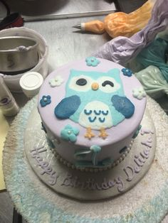 Cute light purple and turquoise owl smash cake!