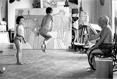 Pablo Picasso in his studio with his children