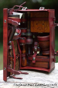 Wonder how to do an adventurers kit, including map making supplies and exploration gear?   LARP Alchemist kit Portable Alchemic lab by MeoLeathercraft