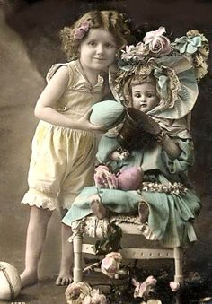 Vintage Studio Photo... Girl,holding EASTER Eggs, with her fancy dressed doll.