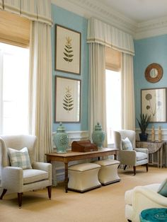 Living Room In Soft Colors Tailored Window Treatment With Textured Roman Shades Behind A Box Pleat Cornice And Looooong Pleated Panels