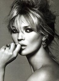 Kate Moss in a messy updo.
