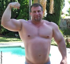 massive huge strong man powerlifter lifting big biceps