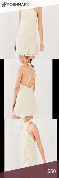 ivory mock neck lace dress NWT Urban Outfitters Ecote Daisy Lace Mock-Neck Mini Dress- Ivory. Dreamy daisy-striped lace mini dress. Sleeveless bodycon fit with a mock-neck + plunging open back with daisy straps. Lined with a slip underneath and finished with an invisible zipper at the back. Model is 5'9in. and wearing size Small. Retail $98 Urban Outfitters Dresses Mini