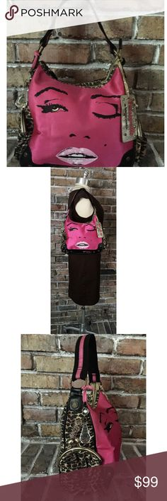"""Betsey Johnson Marilyn Monroe Wink Satchel Bag Rare ~ Circa 1980s Hot Pink Marilyn Monroe face wink print on the front with pouty lips. Durable canvas leopard Satchel w/ satin ribbon trim. Upscaled brass hardware adorns unique snap side coin purses 👛. Crystal & 2 Betseyville hang tags just make it that much better! 12""""Wx5""""Dx9.5H; Strap Drop: 8""""  EUC. Interior & exterior show minimal to no signs of use. The Betseyville name tag has some wear (see pics). Smoke free/smells clean.  Great deal…"""