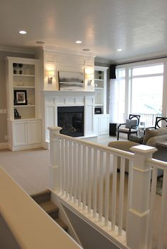 love this whole design for built-ins and fireplace surround