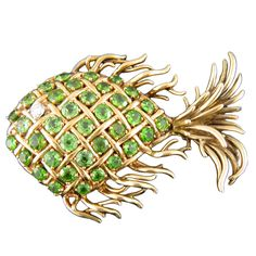 TIFFANY & CO Demantoid Fish Pin | From a unique collection of vintage brooches at https://www.1stdibs.com/jewelry/brooches/brooches/