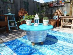 s 15 budget outdoor updates to turn your yard into a relaxing getaway, outdoor furniture, outdoor living, Make a coffee table fire pit with a bucket