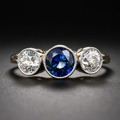They made one with a Ruby too... Wonder if they could do three diamonds! It would be like the other one i found and liked! Antique Style Sapphire and Diamond Ring - 30-1-5463 - Lang Antiques