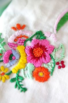 Vibrant embroidered flowers.