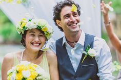 The yellow wedding dress and flower crown with cascading ribbons is a great look but look at how CUTE these two are! The husband and wife are beaming!