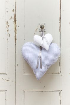 Stuffed pastel or white fabric hearts (possibly filled with lavender) make nice Valentine's Tea Party favors when hung with pretty ribbons from backs of dining room chairs. They're also a wonderful addition hanging from wooden hangers, inside a closet...(Valentines Day craft and decor)