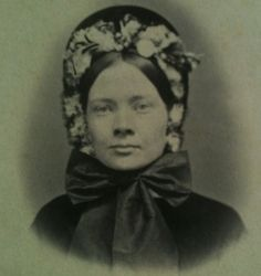 Great pic of a lady wearing a bonnet. American.