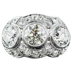 Art Deco 3.65 Carat Diamond Platinum Three-Stone Ring | From a unique collection of vintage engagement rings at https://www.1stdibs.com/jewelry/rings/engagement-rings/