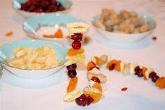 Treat for wild birds using an assortment of dried fruit, peanuts in the shell, and fresh cranberries.