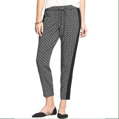 """Printed Tuxedo Pants Women's Drapey Tuxedo Pants in black print. Elasticized waist with drawstring and faux fly, pockets in front. Tapered leg openings - hits above ankle. Smooth, silky poplin-crepe (100% rayon). 27"""" inseam, 12.75"""" leg opening. Just a bit short on me. Old Navy Pants"""