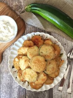 Zucchini (also called courgettes by people with lovely British accents) are funny vegetables; they kind of just creep up on you. If you have ever planted zucchini in your garden, we can bet the fa… Fried Zucchini Chips, Zucchini Chips Recipe, Zucchini Squash, Funny Vegetables, Veggies, Greek Appetizers, Greek Cooking, Greek Recipes, Vegan Recipes