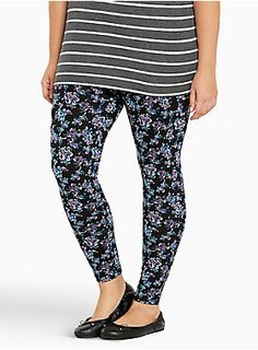"""<p>Perfect when paired with a babydoll dress, these black and blue floral print leggings are giving us some major 90's feels. The stretchy and soft cotton style is thinner than our winter styles, so they're primed for warmer weather.</p>  <ul> <li>29 1/2"""" inseam</li> <li>Cotton/spandex</li> <li>Wash cold, dry low</li> <li>Imported plus size leggings</li> </ul>"""