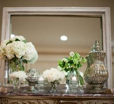 Mantel-mirror combo: Antique white, wood, silver, crystal, flowers. Flowers change with the season.