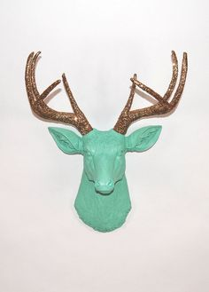 holy goodness, i don't know why but i want this.  The Arnie SALE - Seafoam Green W/ Gold Glitter Antlers Resin Deer Head- Stag Resin White Faux Taxidermy