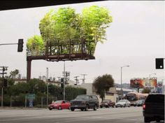 Urban Air is a project by artist Stephen Glassman based in LA. Funded by a Kickstarter campaign, this project answered public desires to see abandoned, unused billboards scattered around the urban landscape transformed into bamboo gardens to combat the city's notorious smog problem. The reuse and recycling of outdoor advertising space into areas of clean air production is an innovative way to address a real city problem.  http://stephenglassmanstudio.net/index.php?/project/urban-air/