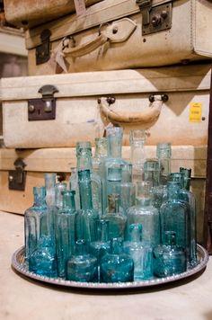 Collection of blue bottles Leftovers Brenham Texas www. Old Glass Bottles, Antique Bottles, Vintage Bottles, Bottles And Jars, Antique Glass, Genie Bottle, Bottle Top, Blue Bottle, Altered Bottles