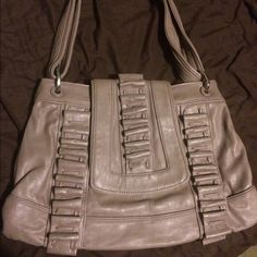 Silver/gray mark. by Avon shoulder bag Gray/silver shoulder bag by mark. Avon. Lightly used. Color is a tad bit faded but barely noticeable. Magnetic closure. Light and cute. Good condition. Avon Bags Shoulder Bags