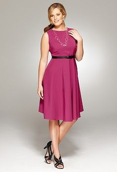 Sleeveless, plus sized, high necked, full skirted... perfect dress for a plus sized pear shaped gal.