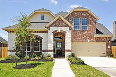 Welcome to Richmond TX Home Search - entering this home you are greeted by an amazing 11 foot coffered ceiling. The interior showcases art niches. Coventry Homes, Building A House, Mansions, House Styles, Stone, Design, Home Decor, Rock, Decoration Home