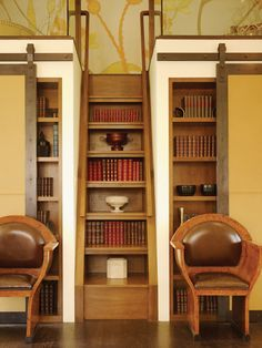 Staircase bookcase and barn doors. This is exceptional, in a way, yet totally far fetched.