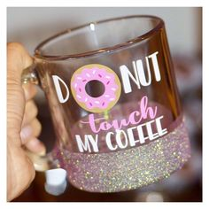 Donut Touch My Coffee glitter dipped mug.  Twinkle Twinkle Lil Jar glitter dipped coffee mugs are a great addition to your mug collection. They are microwave safe for the busiest moms and boss ladies who cant seem to drink their coffee fast enough. Our glitter mugs are the perfect gift for the stylish woman in your life, or for yourself! Every woman deserves a little sparkle in their lives.  Please Checkout my website for more styles: www.twinkletwinkleliljar.com Every customizable glitter…
