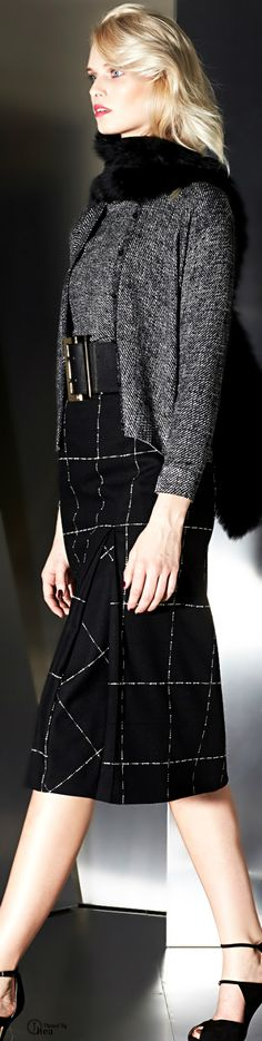 beautiful fabric and stitch details. Simple silhouettes with slightly cascading front jacket.