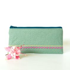 A simple and stylish seafoam green felt pouch with decorative embroidery stitching in dusky pink and pastel yellow. The pouch is lined with a stunning Liberty of London cotton lawn fabric called Strawberry Thief featuring birds, flowers and foliage. Felt Wallet, Pastel Yellow, Pink, Cotton Lawn Fabric, Liberty Of London, Sea Foam, Zip Around Wallet, Purses, Green