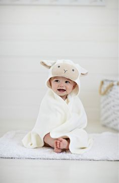 This snuggly wrap with a cute little hood keeps baby cozy and warm after bath time.