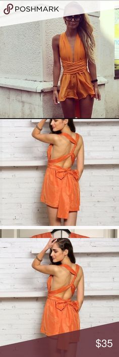 Orange backless romper and playsuit EUC this is a very Versatel outfit, you can take the sash can be done in many ways you can and you can be creative with tying the sash and create a hole new look. I don't see any damage and I never wore it, bought it from another Poshers. Other