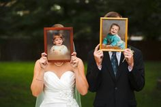 husband and wife hold up there aby pictures instead of pic of face.