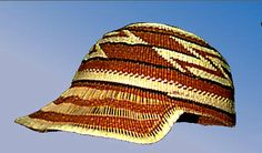 """Woman's hat with extended bill forming a baseball-style hat; Woven primarily in plain twining with 3-strand twining on base and lattice twining on base and near rim; Rim on extended """"bill"""" is wrapped; All designs done in bear grass and woodwardia and maidenhair ferns in half-twist overlay and include geometrics and plain bands; Extended """"bill"""" shows several bands of exposed warps. Dimensions (cm)Height = 11.5, Max Diam = 18.5, Max Length = 25.0"""