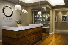 I like the simple front desk design. The wood adds a warm and inviting element.